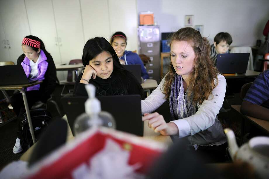 Sixth grade humanities teacher Helana Corda, an eight year veteran of the school and former Teach For America participant, helps student Lesly Vega as the class prepares for an upcoming computer based portion of the S-BAC test, at James Lick Middle School in San Francisco, CA on Friday, April 24, 2015. Photo: Michael Short, Special To The Chronicle