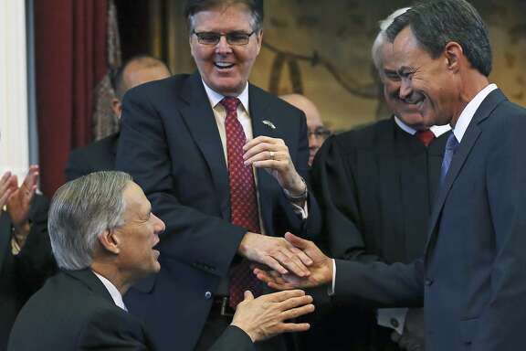 Joe Straus accepts congratulations from Governor elect Greg Abbott and Lt. Governor elect Dan Patrick after being sworn in as Speaker of the House during the opening of the 2015 Legislature at the State Capitol on January 13, 2015.