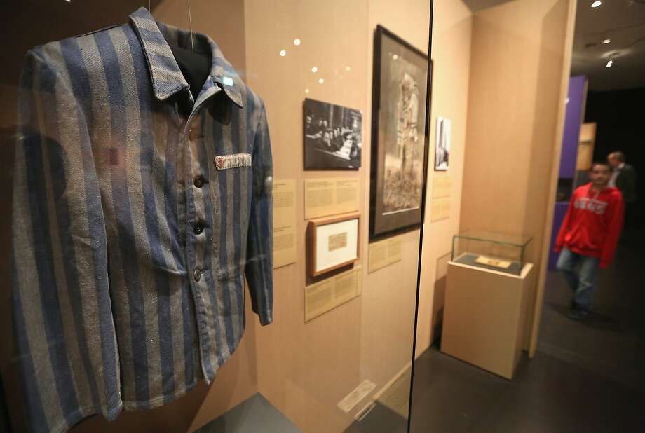 BERLIN, GERMANY - APRIL 24:  The jacket of Polish concentration camp prisoner Feliks Wojciechowski hangs in the exhibition '1945. Niederlage. Befreiung. Neuanfang '('1945. Defeat. Liberation. New Beginning.') at the Deutsches Historisches Museum (German Historical Museum) on April 24, 2015 in Berlin, Germany. In recognition of the 70th anniversary of the German capitulation, the exhibition concentrates on Germany and eleven other countries - Austria, Czechoslovakia, Poland, Great Britain, Denmark, Norway, Luxembourg, the Netherlands, Belgium, France and the Soviet Union -  at the end of the War and during the years immediately following it.  (Photo by Adam Berry/Getty Images) Photo: Adam Berry, Getty Images