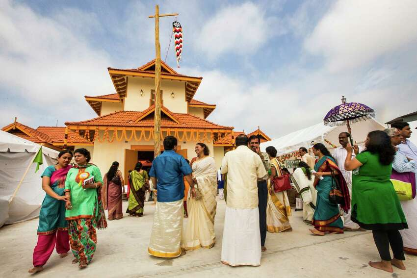 Worshipers gather outside the new Sri Guruvayurappan temple during a ritual Thursday. The temple has about 300 member families, part of the Kerala immigrant community in Houston.