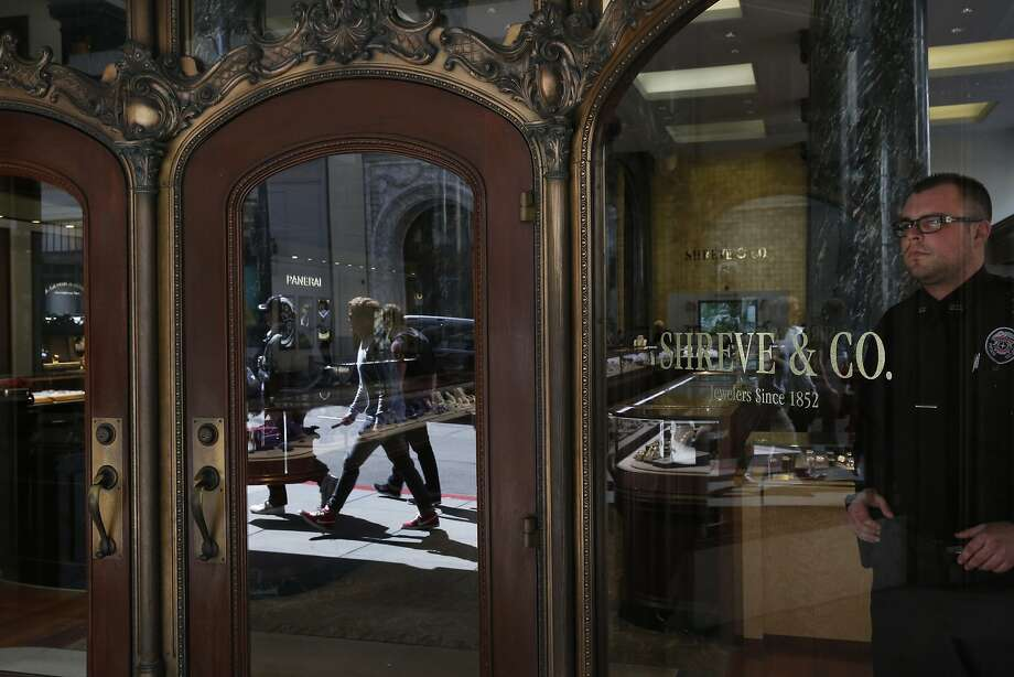 Private security guard Scott Huber keeps watch through a window at Shreve & Co. April 24, 2015 in San Francisco, Calif. Photo: Leah Millis, The Chronicle