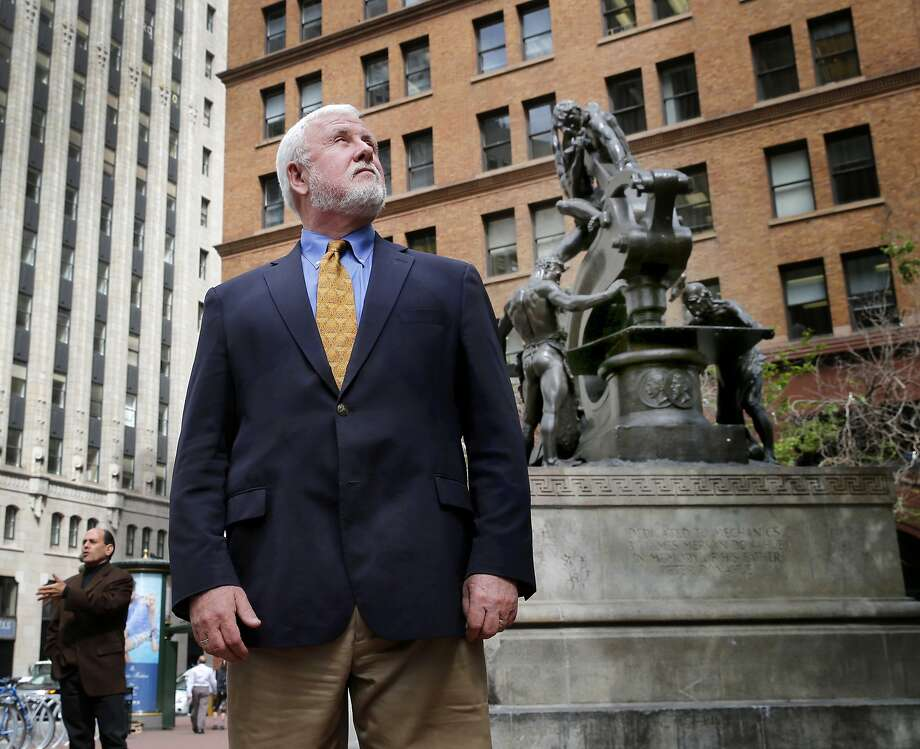 Jim Delgado pauses in front of the Donahue Mechanics Monument which depicts metal workers building a ship Wednesday April 22, 2015. Jim Delgado, San Francisco historian and adventurer, visits the Mechanics Monument Plaza on Market Street. Photo: Brant Ward, The Chronicle