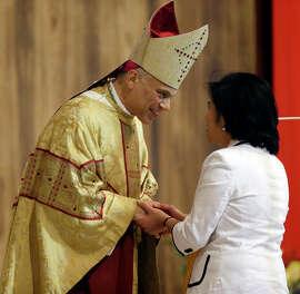 San Francisco Archbishop Salvatore Cordileone greets a parishioner at a ceremony in 2012.