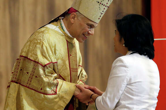San Francisco Archbishop Salvatore Cordileone greets a parishioner at a ceremony in 2012.