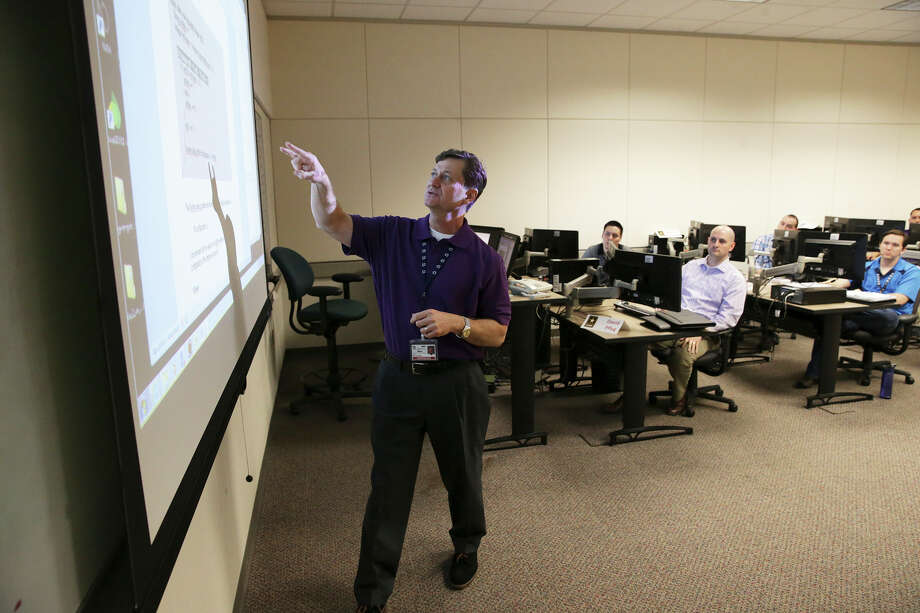 Instructor Glenn Anderson lays out methodology to students in the VetFIT program. The program trains vets in Java in collaboration with Project Quest and the Texas Workforce Commission. Photo: Tom Reel /San Antonio Express-News