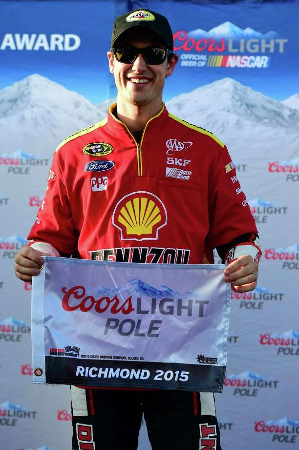 RICHMOND, VA - APRIL 24:  Joey Logano, driver of the #22 Shell-Pennzoil Ford, celebrates after winning the Coors Light Pole Award for the NASCAR Sprint Cup Series Toyota Owners 400 at Richmond International Raceway on April 24, 2015 in Richmond, Virginia.  (Photo by Jared C. Tilton/Getty Images) ORG XMIT: 532027491 Photo: Jared C. Tilton / 2015 Getty Images