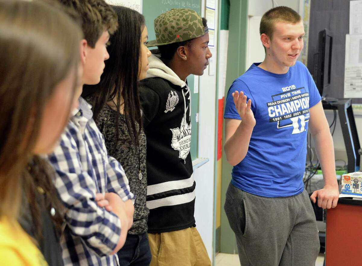Columbia High student Tucker McKeown, right, and classmates speak to middle school students about their experiences at Goff Middle School Friday April 24, 2015 in East Greenbush, NY. (John Carl D'Annibale / Times Union)