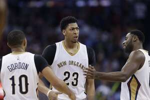 New Orleans Pelicans forward Anthony Davis (23) facts with guard Eric Gordon (10) and guard Tyreke Evans (1) in the second half of an NBA basketball game against the Golden State Warriors in New Orleans, Tuesday, April 7, 2015. The Pelicans won 103-100. (AP Photo/Gerald Herbert)