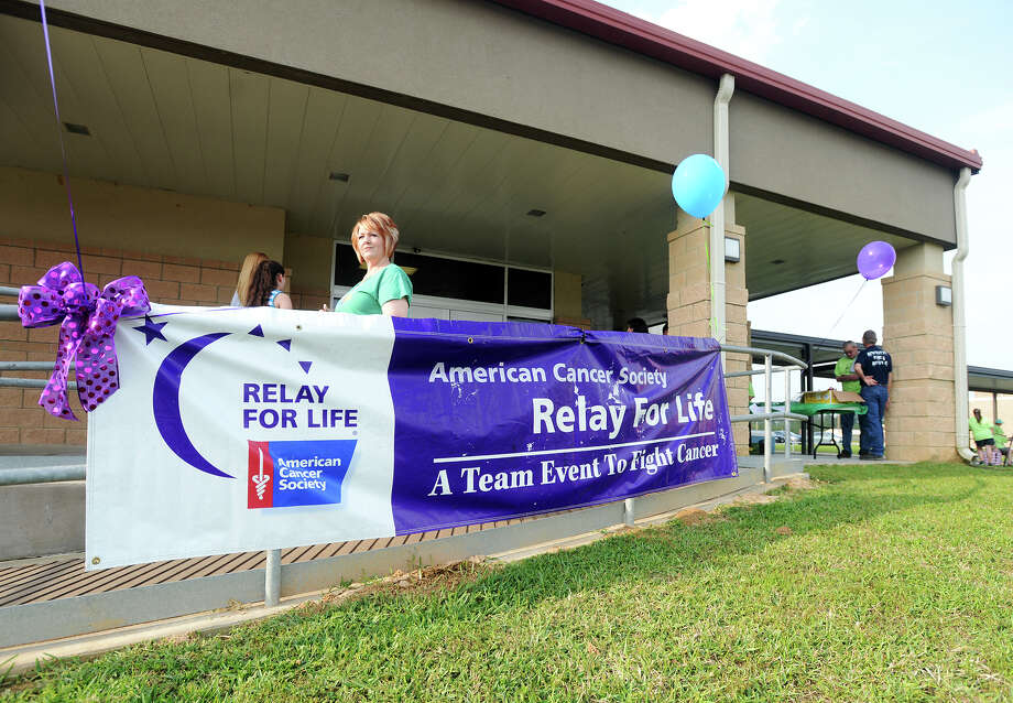 A sign hangs outside the Kountze High School gym. The Relay For Life event was moved inside due to weather concerns. The Hardin/South Jasper Relay For Life event was held Friday night in the Kountze High School gymnasium. Rhonda Brown, community manager, said the event drew 28 teams and was expected to host around 500 participants.  Photo taken Friday 4/24/15 Jake Daniels/The Enterprise Photo: Jake Daniels / ©2015 The Beaumont Enterprise/Jake Daniels
