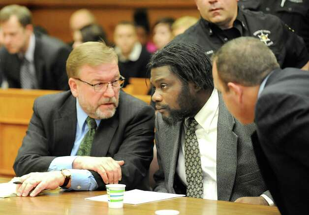 Herman Robinson, center, speaks with assistant public defender Sven Paul, left, and law intern Nathan Writer following Robinson's guilty verdict on Friday, April 24, 2015, at Schenectady County Court in Schenectady, N.Y. Robinson will be sentenced 100 years to life for repeatedly raping a girl over a several year span and then delivering and killing the baby they conceived. (Cindy Schultz / Times Union) Photo: Cindy Schultz / 00031584A