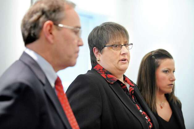 District attorney Robert Carney, left, joins assistant district attorneys Tracey Brunecz, center, and Christina Tremante following the guilty verdict of Herman Robinson on Friday, April 24, 2015, at Schenectady County Court in Schenectady, N.Y. (Cindy Schultz / Times Union) Photo: Cindy Schultz / 00031584A
