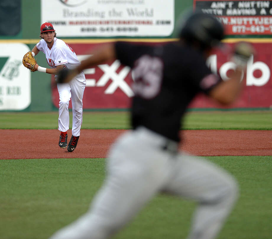 Lamar's Stijn Van Dermeer looks to turn the play to out the runner at first during Friday's home game against Incarnate Word. Photo taken Friday, April 24, 2015 Kim Brent/The Enterprise Photo: Kim Brent / Beaumont Enterprise