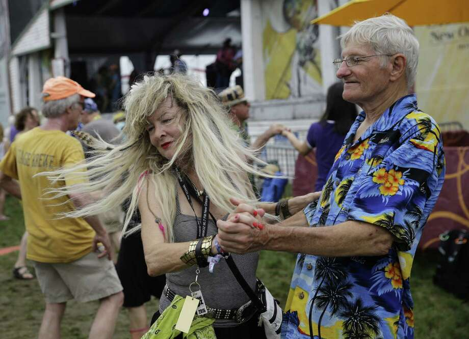 Chris Boone, right, of New Orleans, dances with Zydebooty, as she only wanted to be identified, while Geno Delefose & French Rockin' Boogie perform at the New Orleans Jazz and Heritage Festival in New Orleans, Friday, April 24, 2015. (AP Photo/Gerald Herbert) Photo: Gerald Herbert, Associated Press / AP