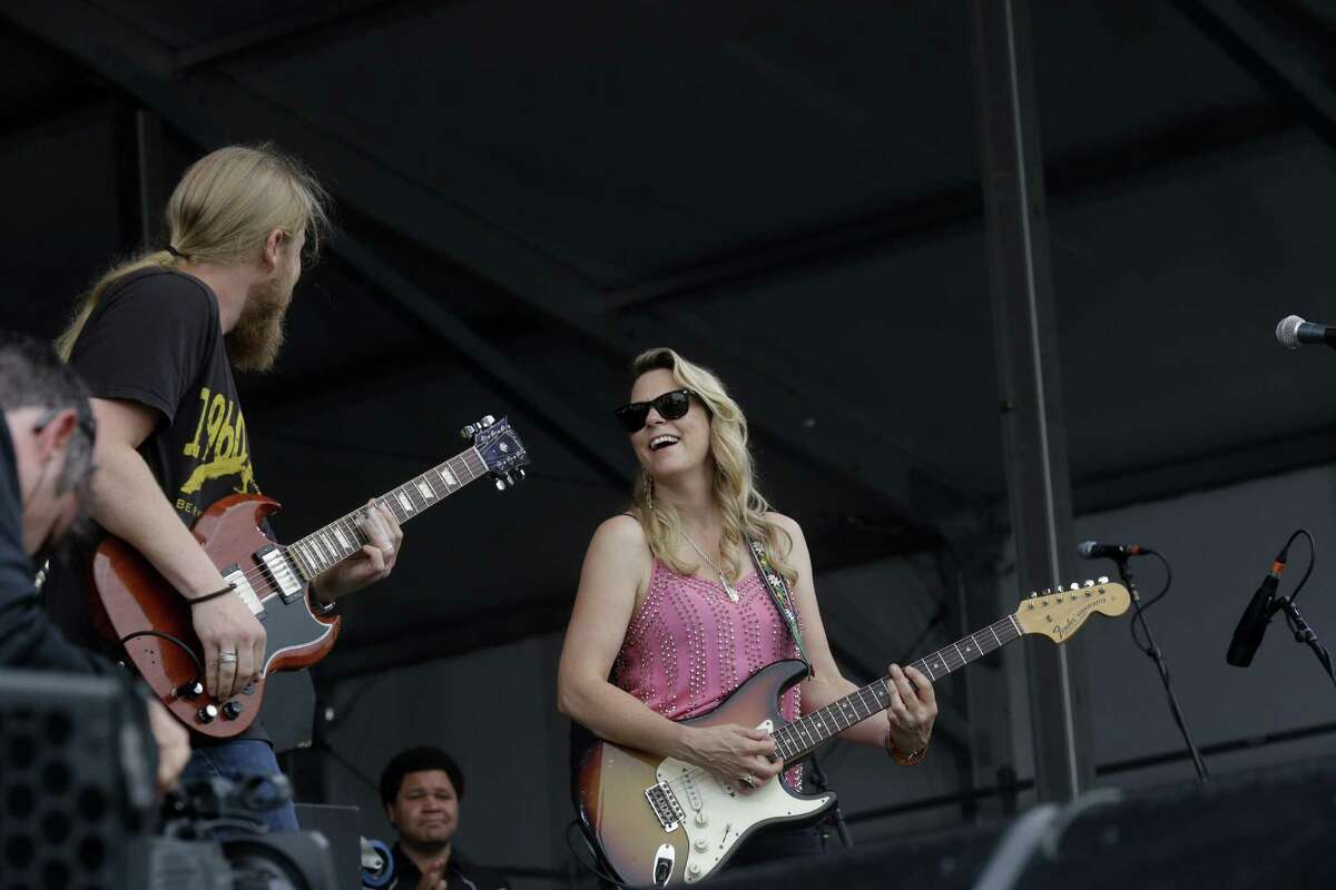 Derek Trucks and Susan Tedeschi perform with the Tedeschi Trucks Band at the New Orleans Jazz and Heritage Festival in New Orleans, Friday, April 24, 2015. (AP Photo/Gerald Herbert)
