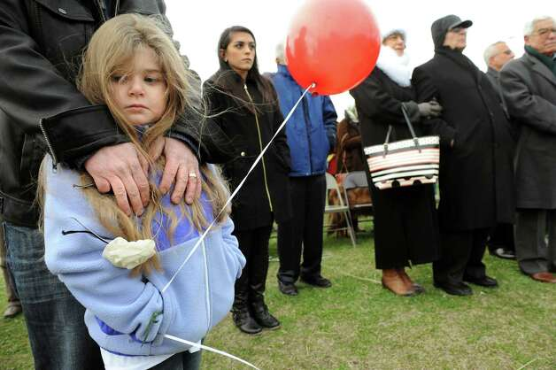 Amy Karageozian, 5, of Colonie stands with her father, Steve Karageozian, to remember their Armenian forebearers on Friday, April 24, 2015, at Riverfront Park in Troy, N.Y. The event commemorate the April 1915 anniversary of the killing of Armenians by Turks. (Cindy Schultz / Times Union) Photo: Cindy Schultz / 00031582A