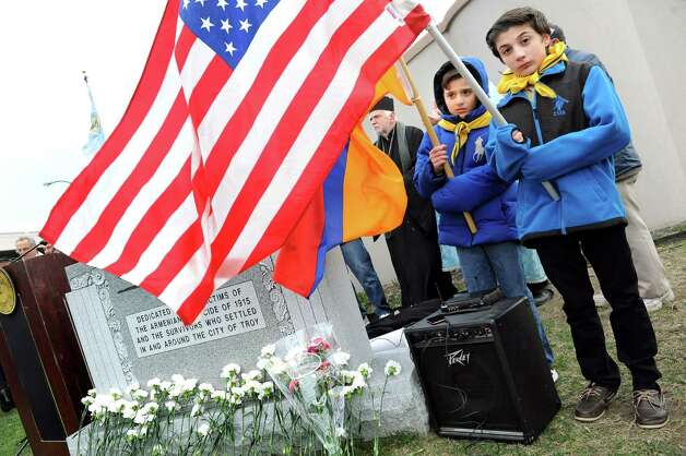 Saro Karageozian, 10, center, and Avo Elebyjian, 13, members of the Armenian Boy and Girl Scouts, hold the Armenian and U.S. flags during a gathering to remember their Armenian forebearers on Friday, April 24, 2015, at Riverfront Park in Troy, N.Y. The event commemorates the April 1915 anniversary of the killing of Armenians by Turks. (Cindy Schultz / Times Union) Photo: Cindy Schultz / 00031582A
