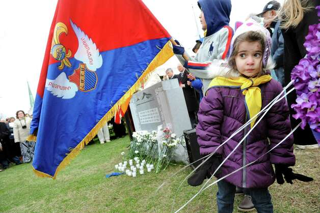 Nanor Karageozian, 6, of Colonie, right, attends a gathering to remember her Armenian forebearers on Friday, April 24, 2015, at Riverfront Park in Troy, N.Y. The event commemorates the April 1915 anniversary of the killing of Armenians by Turks. (Cindy Schultz / Times Union) Photo: Cindy Schultz / 00031582A