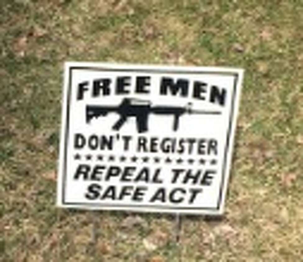 An anti-SAFE Act sign posted in Bethlehem in Apri1 2015. (Rick Karlin/Times Union)