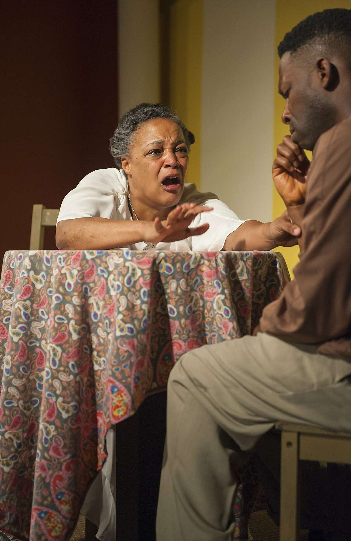 Margaret (Cathleen Riddley) fights to keep her son David (Rotimi Agbabiaka) safe in AlterTheater's production of