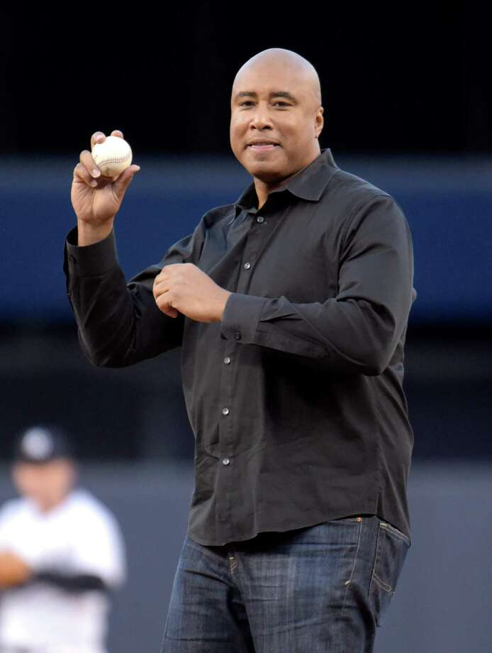 New York Yankees' Bernie Williams throws out the ceremonial first pitch prior to an interleague baseball game against the New York Mets, Friday, April 24, 2015, at Yankee Stadium in New York. (AP Photo/Bill Kostroun) ORG XMIT: NYY106 Photo: Bill Kostroun / FR51951 AP