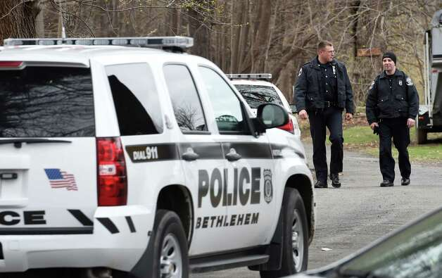 Bethlehem Police officers walk from the woods near Route 144 after searching for a herd of bison Friday morning April 24, 2015 in Bethlehem, N.Y.        (Skip Dickstein/Times Union) Photo: SKIP DICKSTEIN