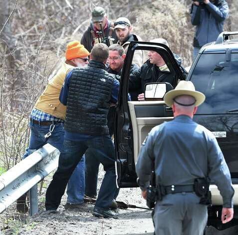 A rifleman is taken in to custody during the killing of the bison herd Friday afternoon April 24, 2015 in Bethlehem, N.Y.        (Skip Dickstein/Times Union) Photo: SKIP DICKSTEIN