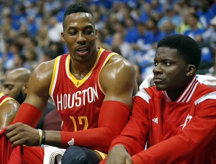 Houston Rockets center Dwight Howard left, speaks with teammate Clint Capela during the first half of Game 3 in the first round of NBA basketball playoffs at the American Airlines Center Friday, April 24, 2015, in Dallas. ( James Nielsen / Houston Chronicle )