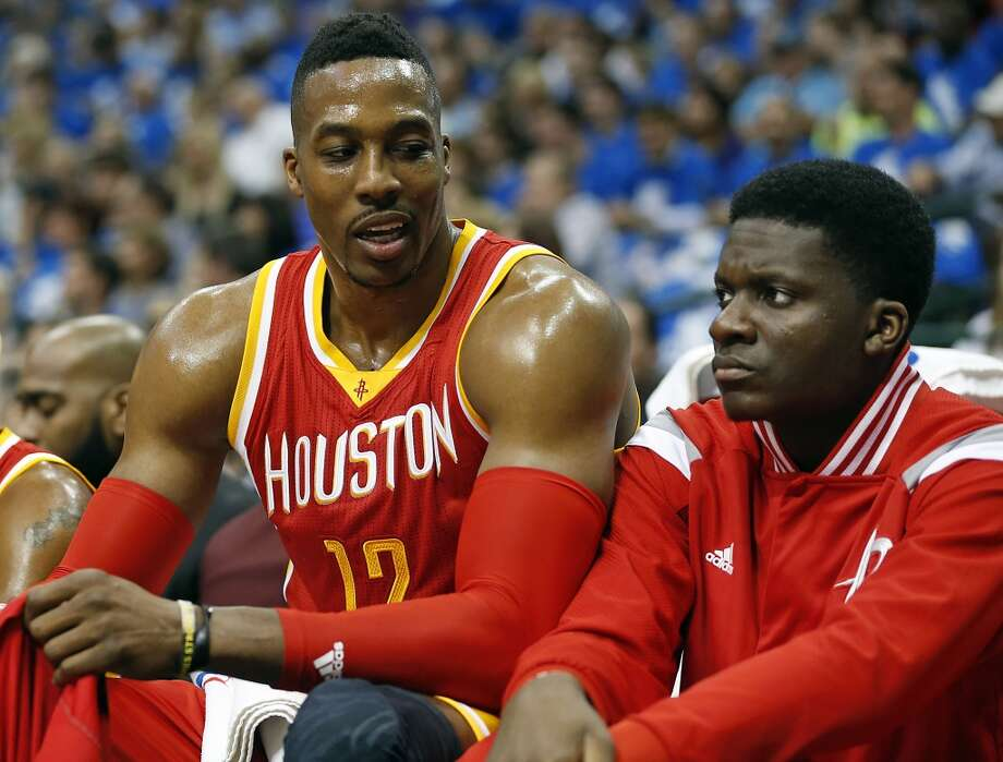 Houston Rockets center Dwight Howard left, speaks with teammate Clint Capela during the first half of Game 3 in the first round of NBA basketball playoffs at the American Airlines Center Friday, April 24, 2015, in Dallas.