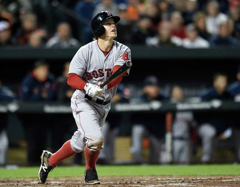 Boston Red Sox's Brock Holt watches his three-run home run against the Baltimore Orioles in the eighth inning of a baseball game, Friday, April 24, 2015, in Baltimore. The Red Sox won 7-5. (AP Photo/Gail Burton) ORG XMIT: MDGB110 Photo: GAIL BURTON / FR4095 AP