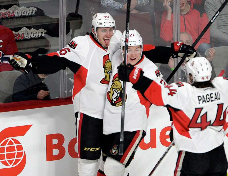 Ottawa Senators defenseman Patrick Wiercioch (46) celebrates with teammates Curtis Lazar and Jean-Gabriel Pageau after scoring against the Montreal Canadiens during the first period of Game 5 of a first-round NHL hockey playoff series, Friday, April 24, 2015, in Montreal. (Ryan Remiorz/The Canadian Press via AP) ORG XMIT: RYR105 Photo: Ryan Remiorz / The Canadian Press