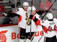 Ottawa Senators defenseman Patrick Wiercioch (46) celebrates with teammates Curtis Lazar and Jean-Gabriel Pageau after scoring against the Montreal Canadiens during the first period of Game 5 of a first-round NHL hockey playoff series, Friday, April 24, 2015, in Montreal. (Ryan Remiorz/The Canadian Press via AP) ORG XMIT: RYR105