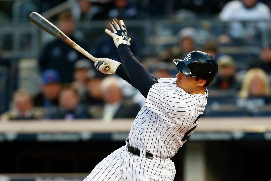 NEW YORK, NY - APRIL 24: Mark Teixeira #25 of the New York Yankees hits a two run home run in the first inning against the New York Mets on April 24, 2015  at Yankee Stadium in the Bronx borough of New York City.  (Photo by Mike Stobe/Getty Images) ORG XMIT: 538578001 Photo: Mike Stobe / 2015 Getty Images