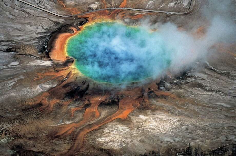 This undated photo provided by Robert B. Smith shows the Grand Prismatic hot spring in Yellowstone National Park's that is among the park's myriad hydrothermal features created by the fact that Yellowstone is a supervolcano, the largest type of volcano on Earth. Photo: Associated Press / Robert B. Smith