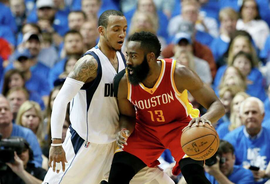 Dallas Mavericks' Monta Ellis, left, defends as Houston Rockets' James Harden (13) looks for an opening to the basket in the second half of Game 3 in an NBA basketball first-round playoff series Friday, April 24, 2015, in Dallas. The Rockets won 130-128. (AP Photo/Tony Gutierrez) ORG XMIT: DNA101 Photo: Tony Gutierrez / AP