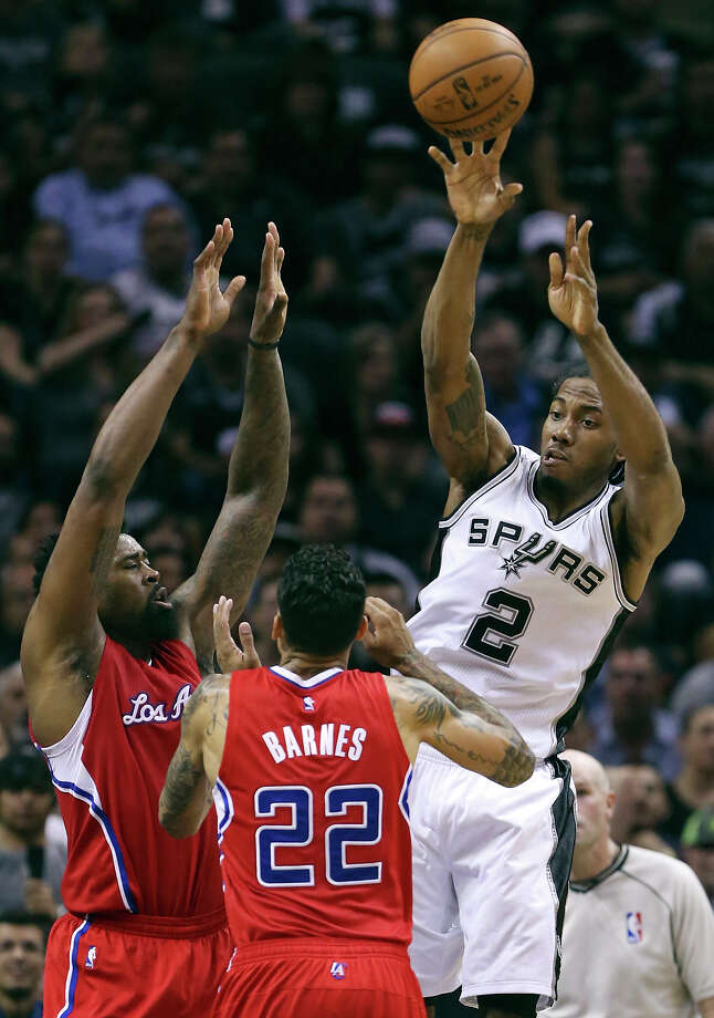 San Antonio Spurs' Kawhi Leonard pass over Los Angeles Clippers' DeAndre Jordan (left) and Matt Barnes during first half action of Game 3 in the Western Conference playoffs Friday April 24, 2015 at the AT&T Center. Photo: Edward A. Ornelas, Staff / San Antonio Express-News / © 2015 San Antonio Express-News
