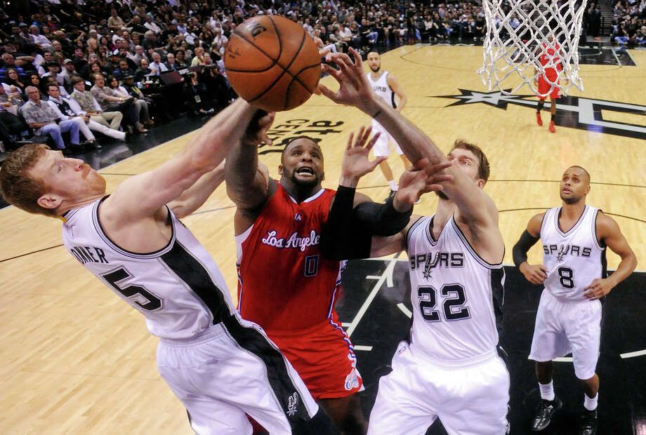 San Antonio Spurs' Matt Bonner (left) and Tiago Splitter grab for a rebound against Los Angeles Clippers' Glen Davis during Game 3 in the Western Conference playoffs Friday April 24, 2015 at the AT&T Center. The Spurs won 100-73. Photo: Edward A. Ornelas, Staff / San Antonio Express-News / © 2015 San Antonio Express-News