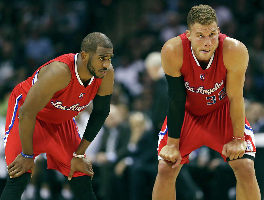 Los Angeles Clippers' Chris Paul (left) and Blake Griffin talk during Game 3 in the Western Conference playoffs against the San Antonio Spurs Friday April 24, 2015 at the AT&T Center. Photo: Edward A. Ornelas, Staff / San Antonio Express-News / © 2015 San Antonio Express-News