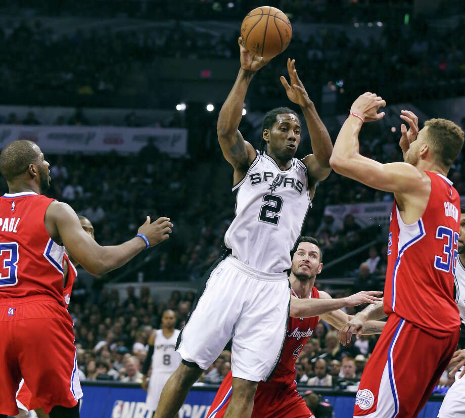 San Antonio Spurs' Kawhi Leonard passes between Los Angeles Clippers' Chris Paul (from left), J.J. Redick, and Blake Griffin during second half action of Game 3 in the Western Conference playoffs Friday April 24, 2015 at the AT&T Center. Photo: Edward A. Ornelas, Staff / San Antonio Express-News / © 2015 San Antonio Express-News