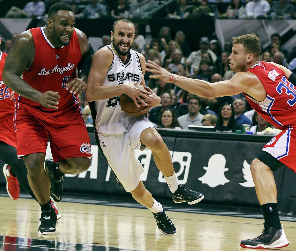 San Antonio has shared the Spurs ups and downs. How about the Spurs sharing more revenue from the AT&T Center? San Antonio Spurs' Manu Ginobili looks for room between Los Angeles Clippers' Glen Davis (left) and Blake Griffin during second half action of Game 3 in the Western Conference playoffs in April.