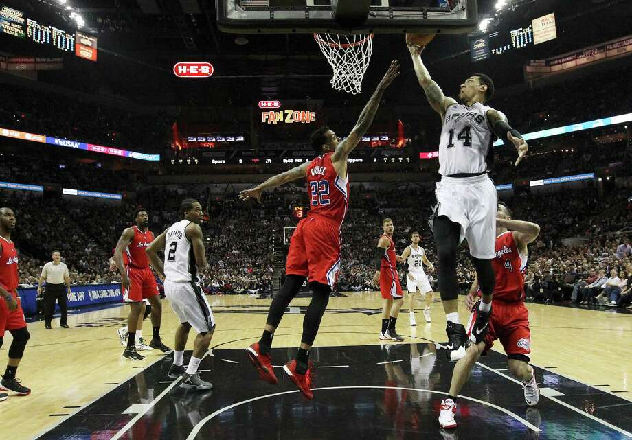 Spurs' Danny Green (14) goes up for a shot against Los Angeles Clippers' Matt Barnes (22) during Game 3 of the Western Conference playoffs at the AT&T Center on Friday, Apr. 24, 2015. (Kin Man Hui/San Antonio Express-News) Photo: Kin Man Hui, Staff / San Antonio Express-News / ©2015 San Antonio Express-News