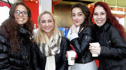 Jessica Estrada, Susha Casale, Barbie Gresak and Nayane Trois keep warm with hot coffee on the chilly first night of the McKinley School Carnival at Jennings Beach.