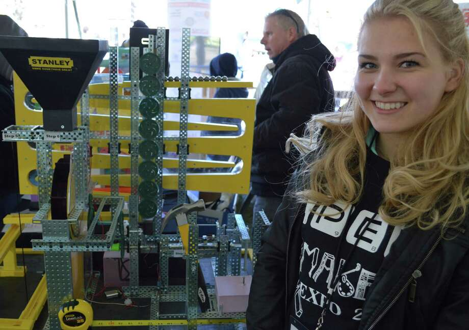 Elena Suddenko of the Connecticut Pre-Engineering Program stands by a Rube Goldberg machine at the Westport Mini Maker Faire. Photo: Jarret Liotta / Westport News