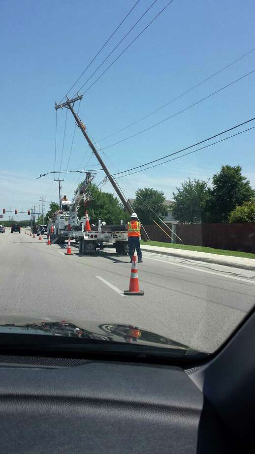 CPS Energy crews repair storm damage near Culebra Road and Timber Path. Photo: Courtesy Lety Caballero