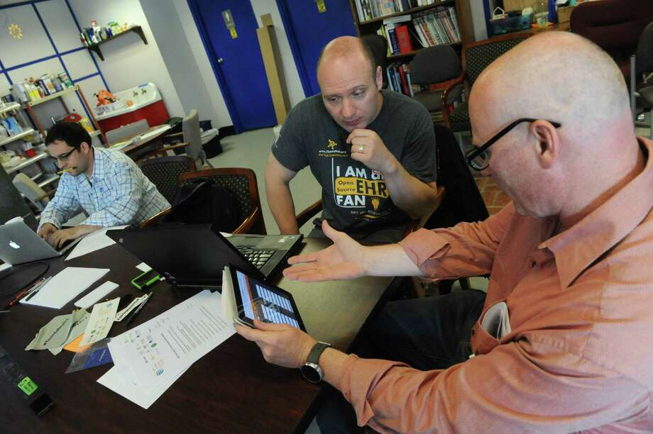 Russell Kirkwood, right, and Ken Zalewski talk tech as The Tech Valley Center of Gravity hosted a day-long hackathon for the $18,000 AT&T app development challenge on Saturday April 18, 2015 in Troy, N.Y. (Michael P. Farrell/Times Union) Photo: Michael P. Farrell / 00031522A
