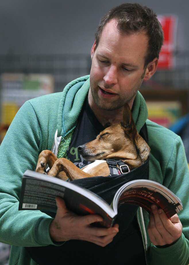Joe Biel attends the 20th annual Bay Area Anarchist Book Fair with his dog Ruby in Oakland, Calif. on Saturday, April 25, 2015. Photo: Paul Chinn, The Chronicle