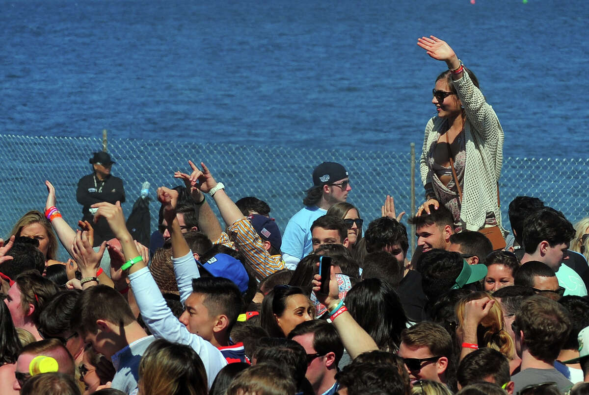 Fairfield University students enjoy a DJ performance during the annual Clam Jam event at Penfield Beach in Fairfield, Conn., on Saturday Apr. 25, 2015. In previous years the Clam Jam was held at various private homes around the beach area but this year is the first year the party was brought to the new location.
