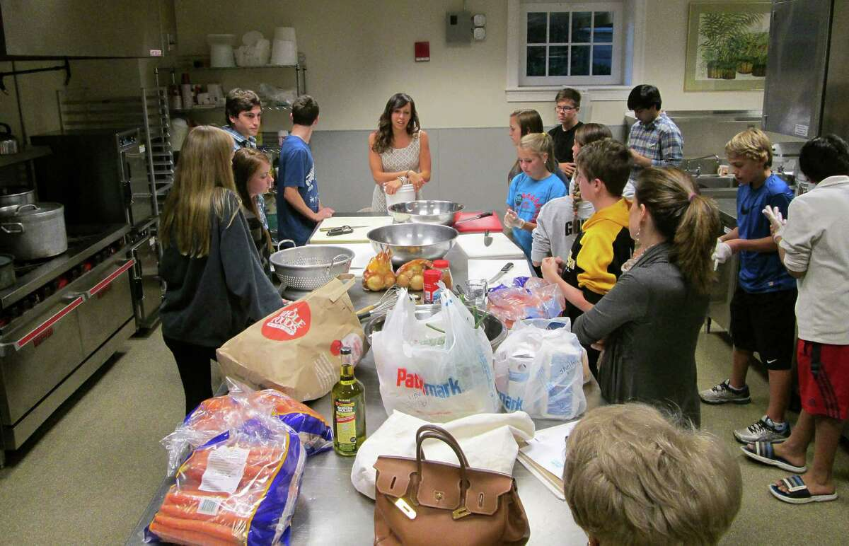 Greenwich High School students prepare meals for the Pacific Street homeless shelter in Stamford, Connecticut, last spring. Stamford resident Dr. Sandi Mond is to be honored at the Shelter for the Homeless fundraiser May 13, 2015 for her efforts to establish a group that engages high school students to help the homeless.
