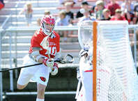 At left, Michael Sands (#40) of Greenwich shoots and scores a goal beating New Canaan goalie Drew Morris during the boys high school lacrosse match between Greenwich High School and New Canaan High School at New Canaan, Conn., Saturday, April 25, 2015. Greenwich won the match, 13-10.