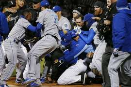 Kansas City Royals and Chicago White Sox players fight during the seventh inning of a baseball game Thursday, April 23, 2015, in Chicago. The Royals won 3-2 in 13 innings. (AP Photo/Andrew A. Nelles)