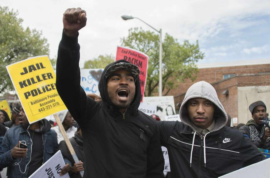 Demonstrators protest the death of Freddie Gray, a black man who suffered a fatal spinal injury while in police custody. Photo: Jim Watson, AFP / Getty Images
